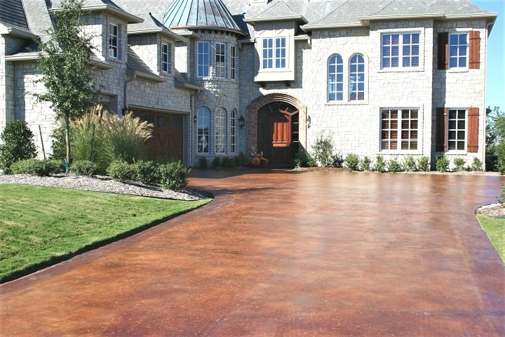 stained concrete driveway orlando in front of house