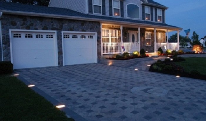 night view of concrete driveway